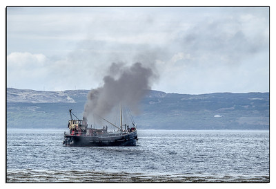 A coal fired Puffer. This is one of two preserved and restored vessels out of a large number which used to ply up and down the Clyde. This one is available for holiday hire as a working holiday.