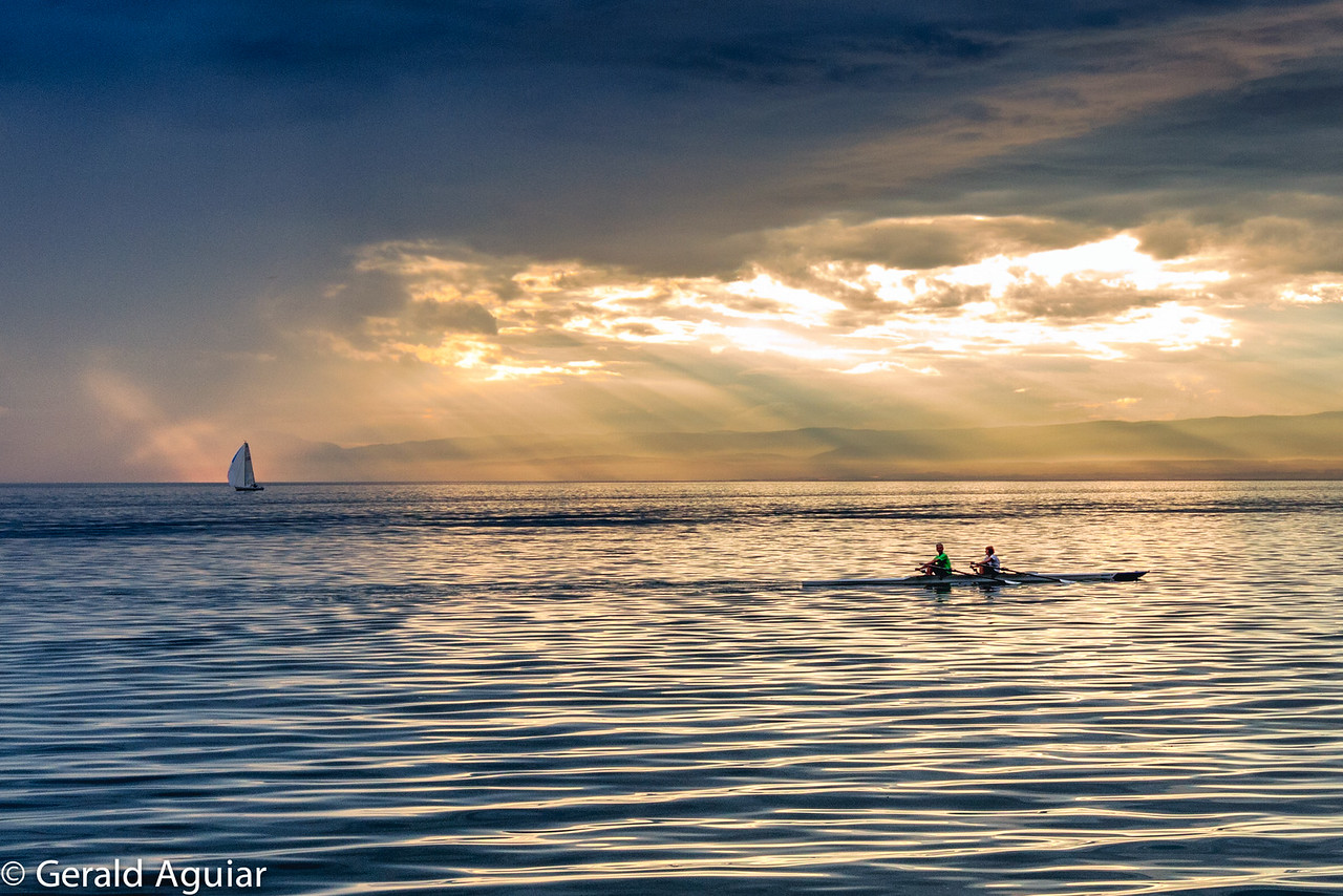 Rowing Duo At Sunset