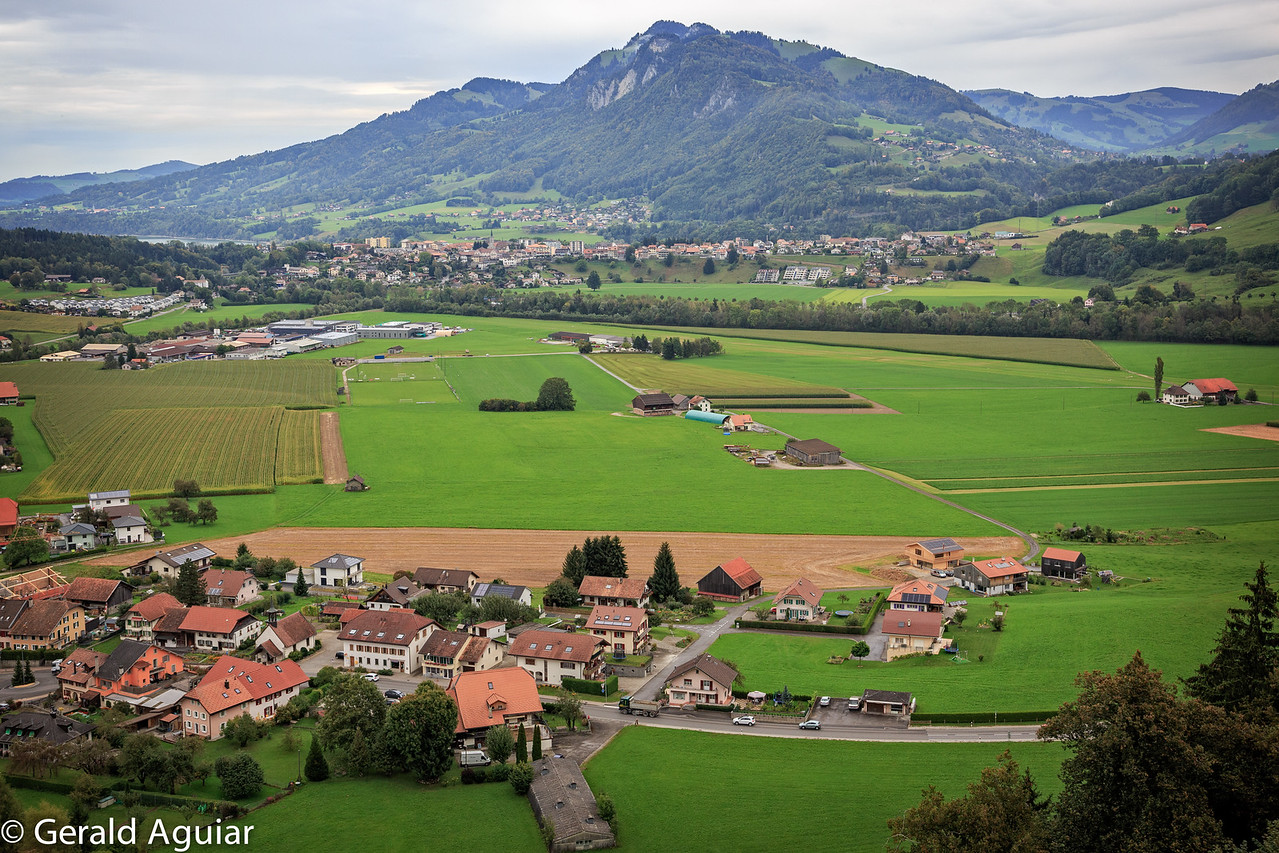 This is a typical valley with homes surrounding agriculture.