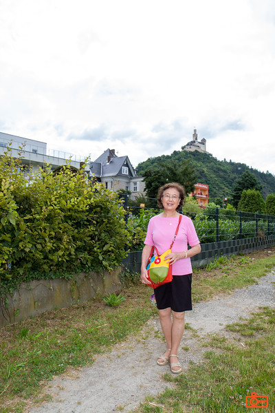 Rosa's mother with Marksburg Castle in the background. The castle construction started around 1100.