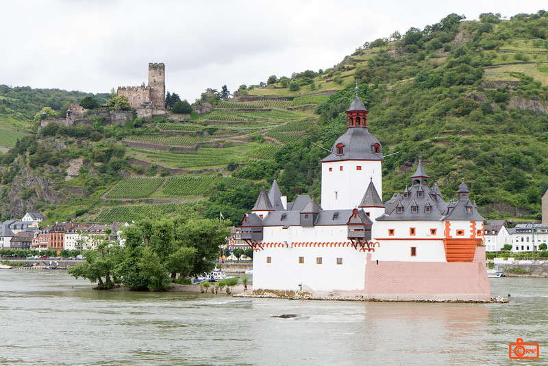 The highly unusual looking Pfalzgrafenstein Castle is a toll castle in the Rhine River. The original keep was built in 1327, and was expanded over the years to its current configuration. In the background is Gurg Gutenfels.