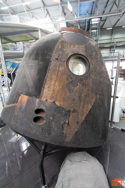 The exterior of the Soyuz TM-19 showing the heat damage from reentry.