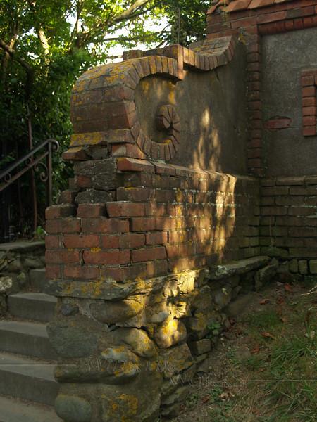 Old wall seen near mansion along the Cliff Walk, Newport