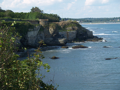 View of stone walls and natural areas along the Cliff Walk, Newport