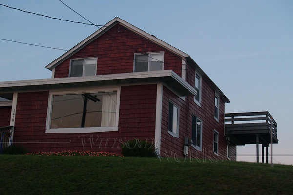 Old red house by Point Judith Light
