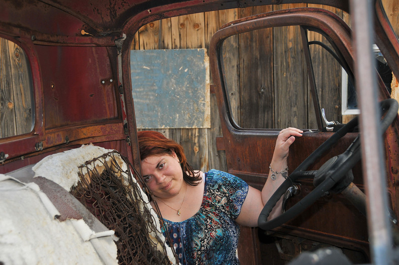 Krissi modeling against a truck behind the Rhyolite Mercantile.