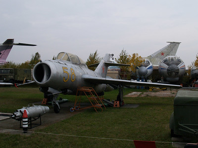 An old MiG in the foreground from the early 50s and a much newer, larger one in the background.