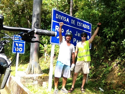 Douglas Engle and Dado Galdieri pose in at the state line between Rio and São Paulo states during a trip on the Rio-Santos highway. The 500 plus kilometer road runs along the Atlantic Ocean, passing through, near and around dozens of beaches, waterfalls, mountains and forest. It is arguably of of Brazil's most beautiful roads. (Australfoto/Douglas Engle)
