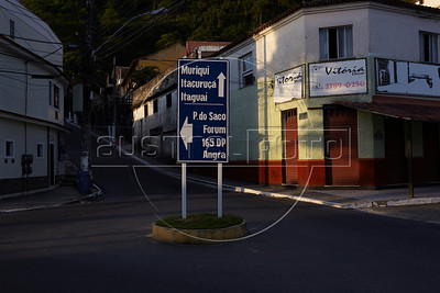 A sign indicates direction in Mangaratiba, Rio state, Brazil, just off the Rio-Santos highway.  The 500 plus kilometer road runs along the Atlantic Ocean, passing through, near and around dozens of beaches, waterfalls, mountains and forest. It is arguably of of Brazil's most beautiful roads. (Australfoto/Douglas Engle)
