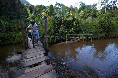 A rickety wooden bridge is the access to the beach and campground in Prumirmim, in the municipality of Ubatuba, São Paulo state, Brazil, just off the Rio-Santos highway. The 500 plus kilometer road runs along the Atlantic Ocean, passing through, near and around dozens of beaches, waterfalls, mountains and forest. It is arguably of of Brazil's most beautiful roads. (Australfoto/Douglas Engle)