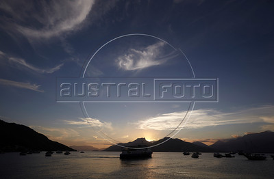 The  Ilha Grande ferry is silouetted by the dusk in Mangaratiba, Rio state, Brazil, just off the Rio-Santos highway. The island makes for a great escape from Rio, but in order to catch the 8am boat to the island, passengers must take a 5am bus from Rio. (Australfoto/Douglas Engle)