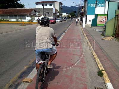 Dado Galdieri rides on one of the many cycle lanes in the town of Ubatuba, São Paulo state Brazil. The town was the final destination of a 340km bicycle trip on the Rio-Santos highway. The 500 plus kilometer road runs along the Atlantic Ocean, passing through, near and around dozens of beaches, waterfalls, mountains and forest. It is arguably of of Brazil's most beautiful roads. (Australfoto/Douglas Engle)