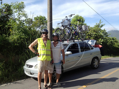 Douglas Engle and Dado Galdieri pose in front of a car and their bikes during a trip on the Rio-Santos highway. The 500 plus kilometer road runs along the Atlantic Ocean, passing through, near and around dozens of beaches, waterfalls, mountains and forest. It is arguably of of Brazil's most beautiful roads. (Australfoto/Douglas Engle)