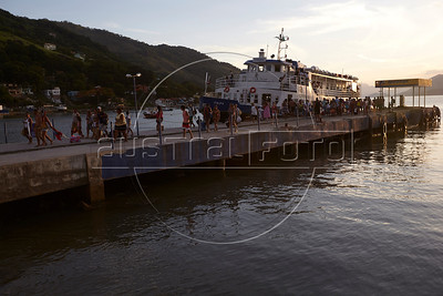 Passengers disembark from the ferry arriving from Ilha Grande in Mangaratiba, Rio state, Brazil, just off the Rio-Santos highway. The island makes for a great escape from Rio, but in order to catch the 8am boat to the island, passengers must take a 5am bus from Rio. (Australfoto/Douglas Engle)