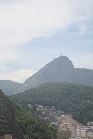 The Statue of Christ perched High Atop Corcovado Mountain<br /> <br /> One of the seven new wonders of the world. It was built in 1931 and has come to be a symbol of Rio de Janeiro. The photo was taken from the roof of Marriott hotel.