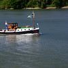 A beautiful vintage boat of some stripe.  A cabin cruiser?  Maybe a converted utility boat?