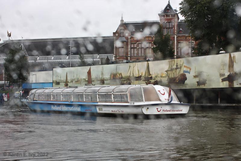 Canal tour boat (through rainy window)
