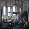 Nave and altar, Dom, with the choir rehearsing in frong