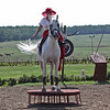 Woman riding dressage, sidesaddle - horse is a Lippizaner