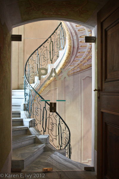 """Spiral staircase; the """"Pax"""" is on the glass door in front"""