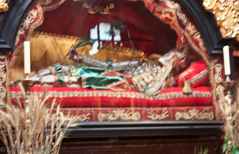 Remains of a saint, behind glass - yes, this is a clothed body, largely mummified