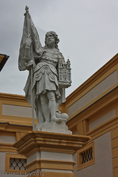 Statue of Leopold II holding a model of the Abbey church