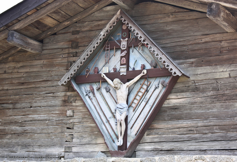 A carpenter's crucifix - notice the tools.