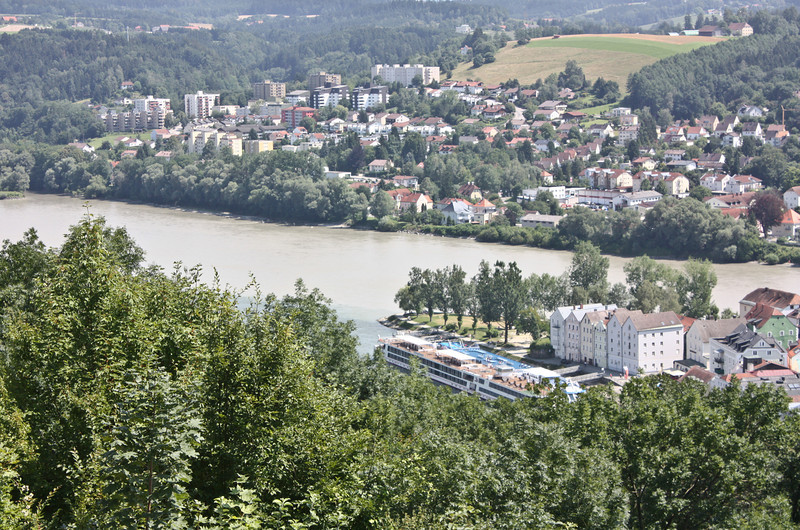 Confluence of the Inn and Danube Rivers with Passau in the background - the boat is on the Danube