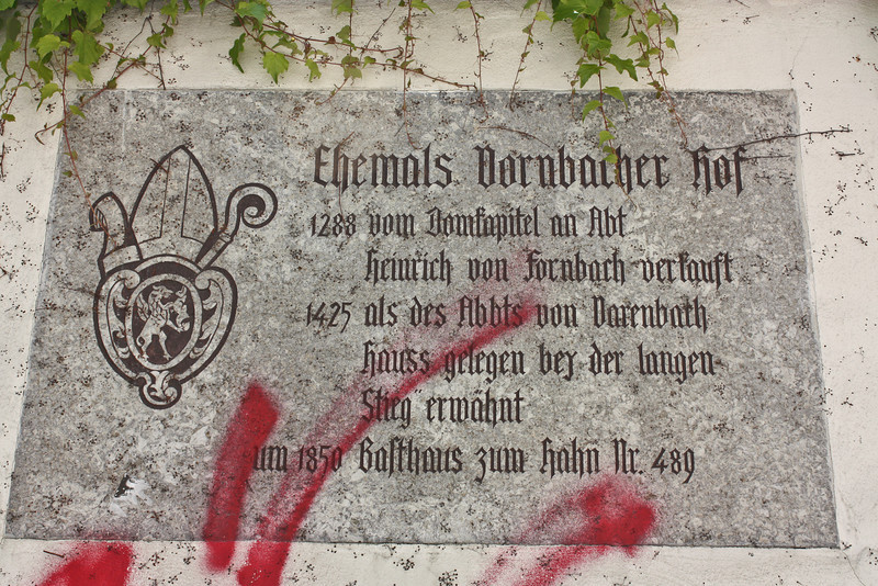 Plaque near the Dom; too bad about the graffiti