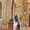 Crucifix with praying statue