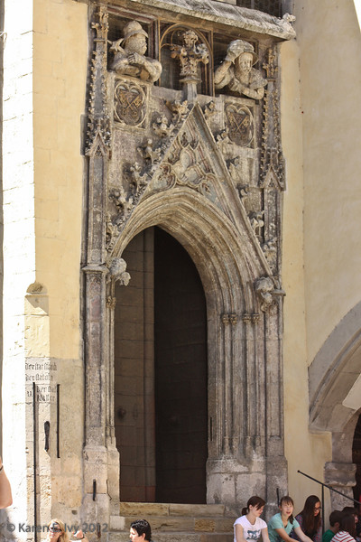 """Old city hall Gothic doorway with """"city keys"""" - the official length measurements used in Regensburg - the shoe or foot, cubit and fathom.  Now you know how much is a cubit - at least here."""