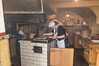 Cooking Sausages at Historic Sausage Kitchen-6000 served daily-only menu item available