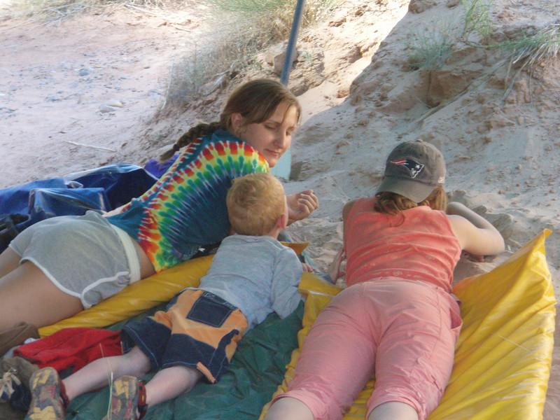 Rachael, Mack, and Alena watching ants.