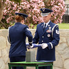 Honor Guards folding a US flag during a military funeral service at Riverside National Cemetery in Riverside, California.