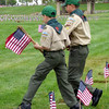 Boy Scout volunteers planting US Flags for the Memorial Day at Riverside National Cemetery in Riverside, California.