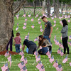 A military family visits and honors a fallen service member at Riverside National Cemetery in California.