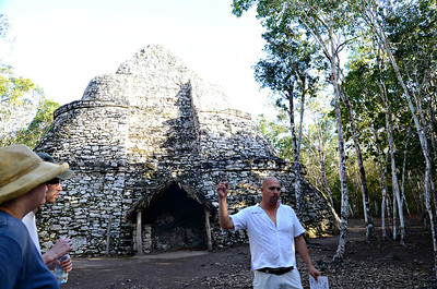 This particular pyramid is a solid structure located at the center of the sacbe (system of paved, white, stone roads.)  The residents of Coba would climb this structure as a watch tower so that they could see who was coming in all directions.