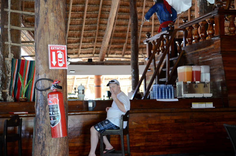 "Ben re-filling the ""Bubbas"" at the pirate ship bar at Captain Morgan's Grill at Barcelo Maya Caribe - Puerto Aventuras, Mexico."