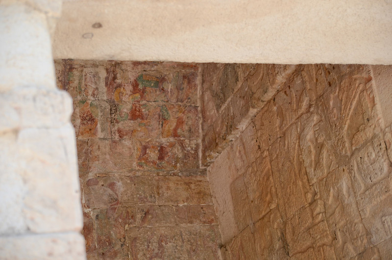 Many of the carvings at Xichen Itza were also originally painted.  Here, you can see some of the original colors of red, gold and turquoise.  This is one of the original, pure Mayan structures built near 400 AD, prior to the merger of the Mayan and Toltec civilizations.