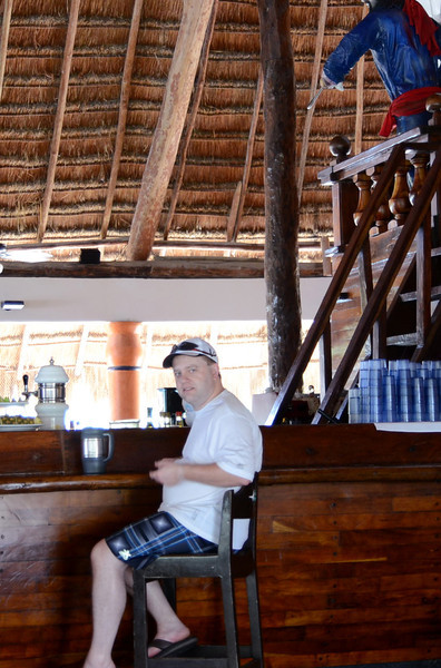 "Ben refilling the ""Bubbas"" at the pirate ship bar at Captain Morgan's Grill at Barcelo Maya Caribe - Puerto Aventuras, Mexico."