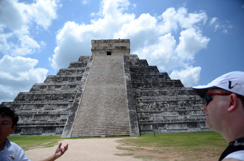 One of the restored sides of El Castillo at Xichen Itza Ruins - Yucatan, Mexico<br /> Our guide explains that a person standing at the base of the pyramid can shout and the echo comes back as a piercing shriek.  He demonstrates this by having us clap in unison.  They pyramid echoes back with a high-pitched yelp.  Likewise, he explains, that a person standing at the top of the pyramid can speak in a normal voice and have their words carry for a long distance surrounding the temple.