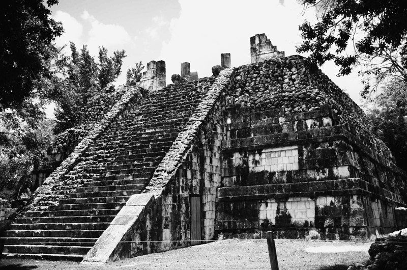 """Constructed in the Toltec style of architecture and surrounded by hundreds of massive, limestone columns, The Temple of the Warriors and the adjacent Temple of the Jaguar make up the expansive """"Thousand Columns"""" section of the ancient city of Xichen Itza."""