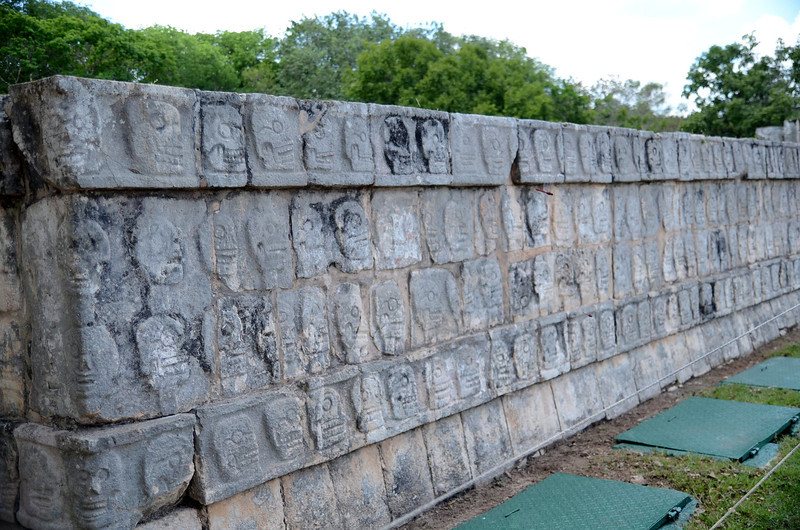 This structure was built between 900 and 1100 AD around the merger of the Mayan people and the Toltecs.  The Mayas were a peaceful, agricultural society.  The Toltecs were a society of warriors.  It is believed that the Platform of the Skulls was built for the purpose of intimidation based on principles integrated from the Toltec culture.<br /> Platform of the Skulls.  Xichen Itza, Yucatan, Mexico