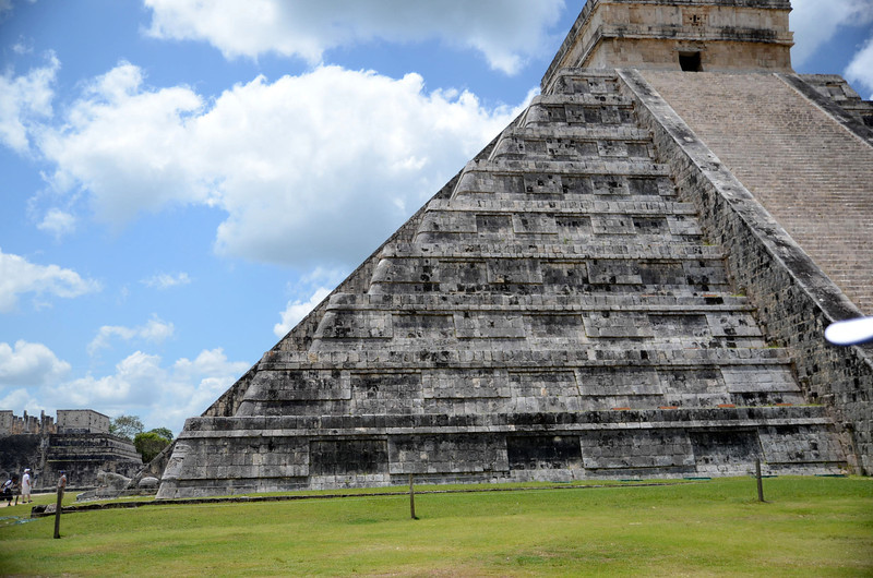 "Each spring and fall, on the equinoxes, you can see Kukulkan descend El Castillo from the heavens.  Here, you can see somewhat of an illustration of how this is created by the shadows of the platforms against the great staircase.<br /> <br /> Kukulkan - (literally translated to ""feathered serpent"") - descending the restored sides of El Castillo at the Xichen Itza Ruins - Yucatan, Mexico"