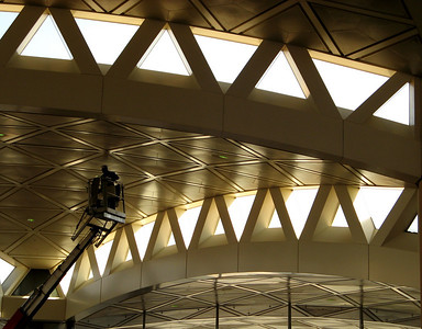 King Khaled International Airport, Riyadh, Saudi Arabia ... mobile cranes carry labor to polish the metal roof tiles.