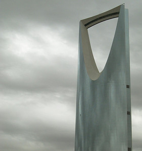 The Kingdom Tower, Riyadh, Saudi Arabia.  An award winning piece of architecture and one of the most striking high rise buildings in the world ... photographed on a rare overcast day; the subtle blue grey glass blending into the overcast grey cloud cover.
