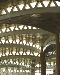King Khaled International Airport, Riyadh, Saudi Arabia ... the elegant roof design (rumoured to have been inspired by the indigenous palm tree) steps up from the periphery of the airport towards the center ... the space created in-between each climb is ingeniously used for natural lighting.