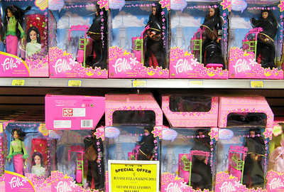 Saudi barbie ... her name is Fulla ... comes in veiled and  casual models... reflects the public and private personna of the Muslim woman.  Shot taken in Toys R Us, Riyadh.