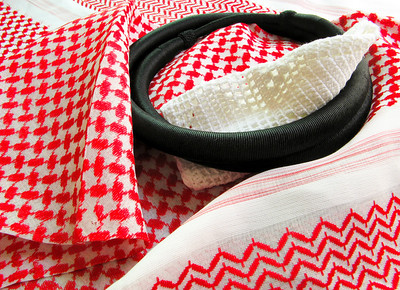 The colorful & elegant Saudi head-dress worn by men ....   ....the cotton red & white chequred head cover is called a shmagh and can come in different colors, the white cap worn underneath is to prevent the shmagh from slipping and is called a tagiyyah....the ringed black wreath, called igal, is put on top to secure both onto the head.