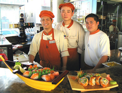 The guys at *Zee Noodle* on Takhassussi Street, Riyadh having just made our delicious California Maki Specials and Saki Sushis!